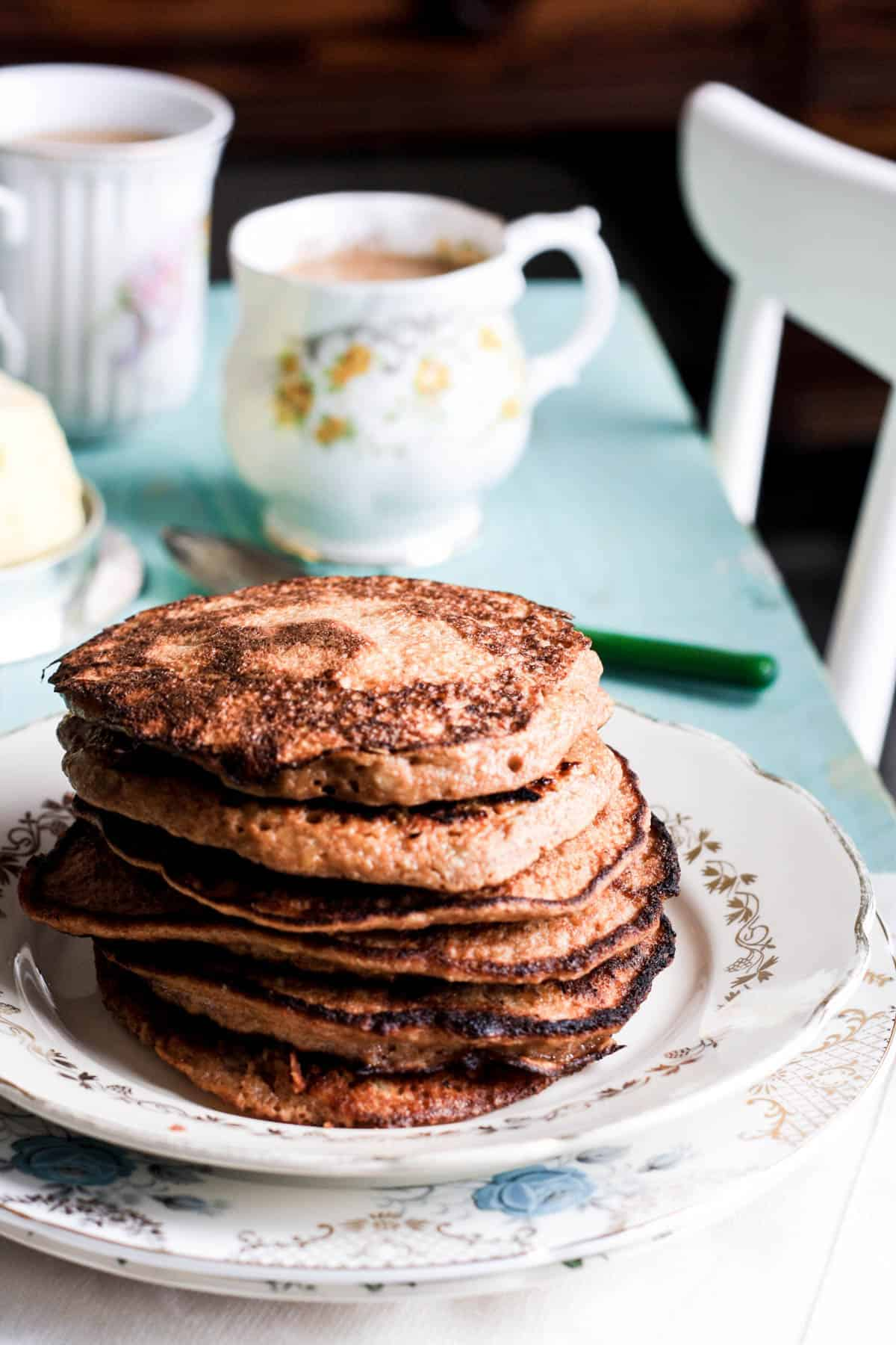 A stack of Banana and Walnut Paleo Pancakes on a plate