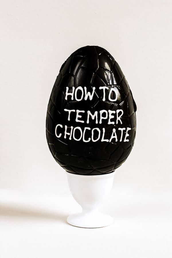 An Easter Egg with How To Temper Chocolate written on the side