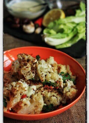 Roasted Cauliflower, Saffron Buttermilk and Black Olive Pangrattato