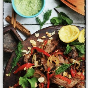 Slow Roast Middle Eastern Lamb with Toasted Almonds, Pine Nuts and Green Tahini Dressing