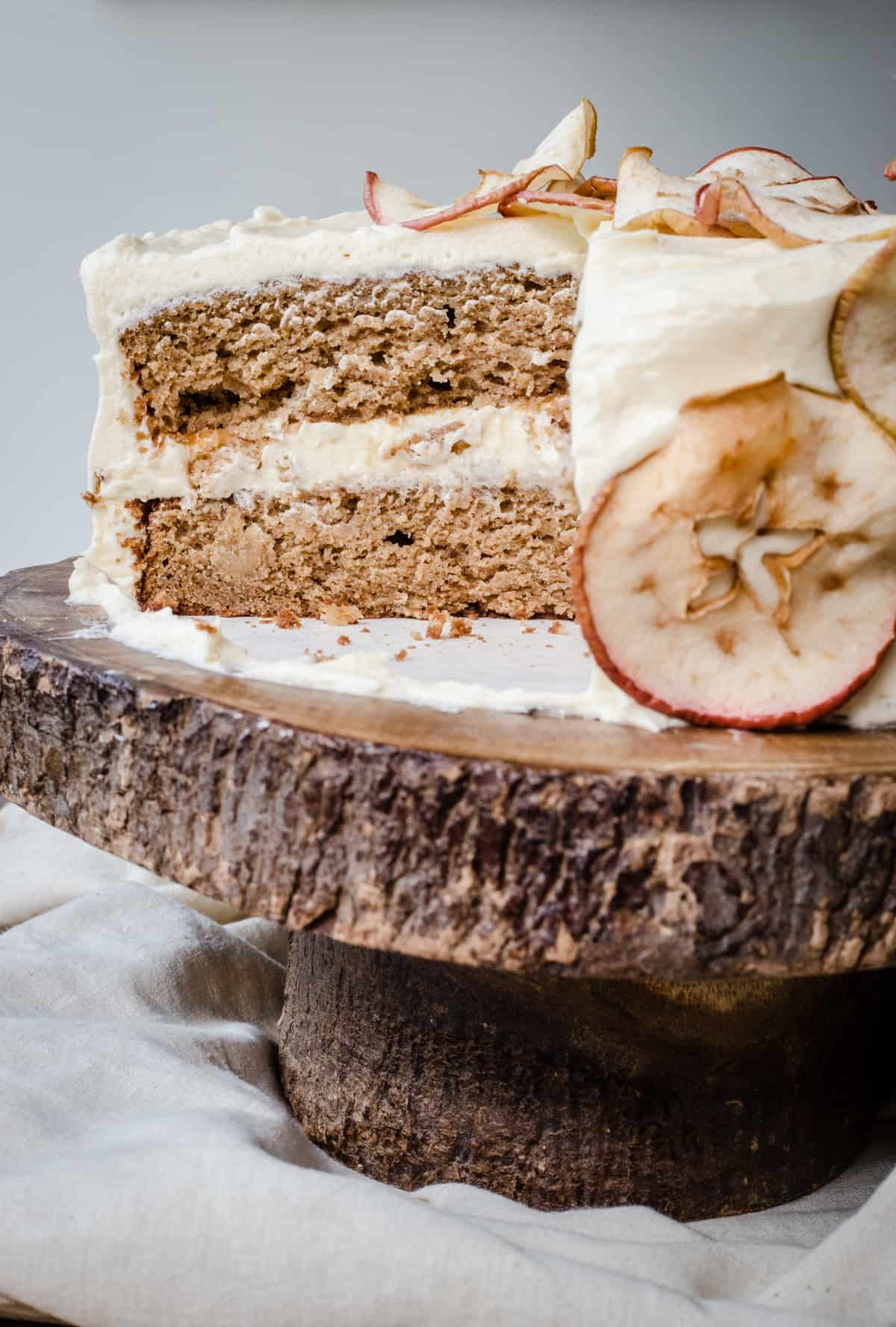 Close up of a cut Apple and Cinnamon Cake with Salted Caramel Cream Cheese Buttercream