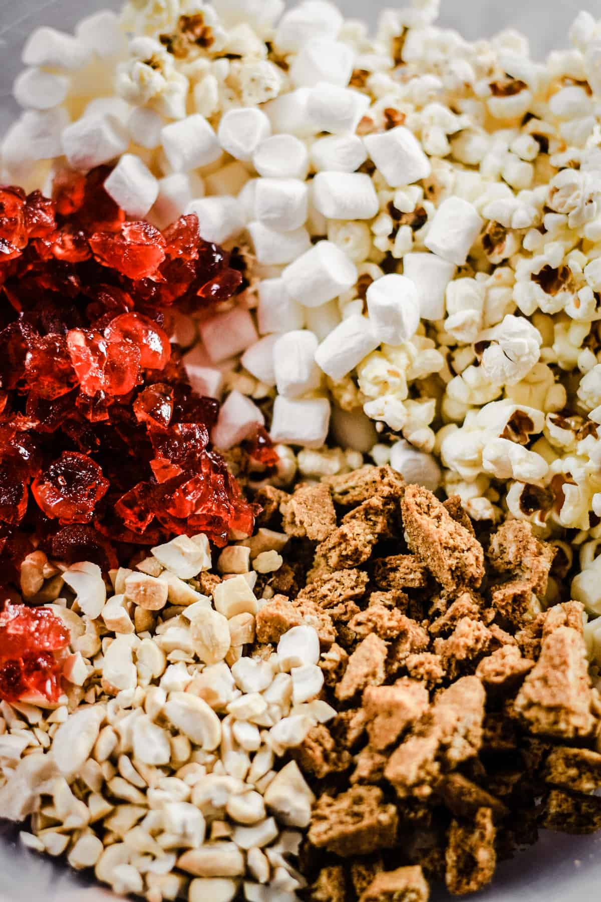 ingredients in a bowl for Ultimate Popcorn Rocky Road