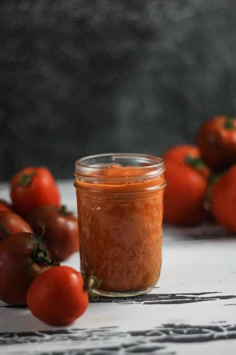 This deliciously rich Roasted Tomato Freezer Sauce is perfect for freezing in small batches for emergency mid-week dinners.