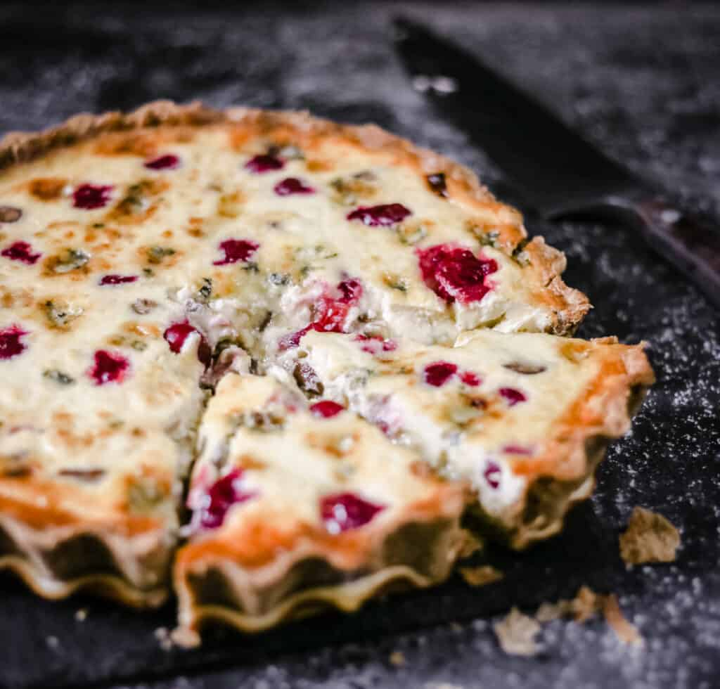 Stilton, Chestnut and Cranberry Tart with a slice taken out
