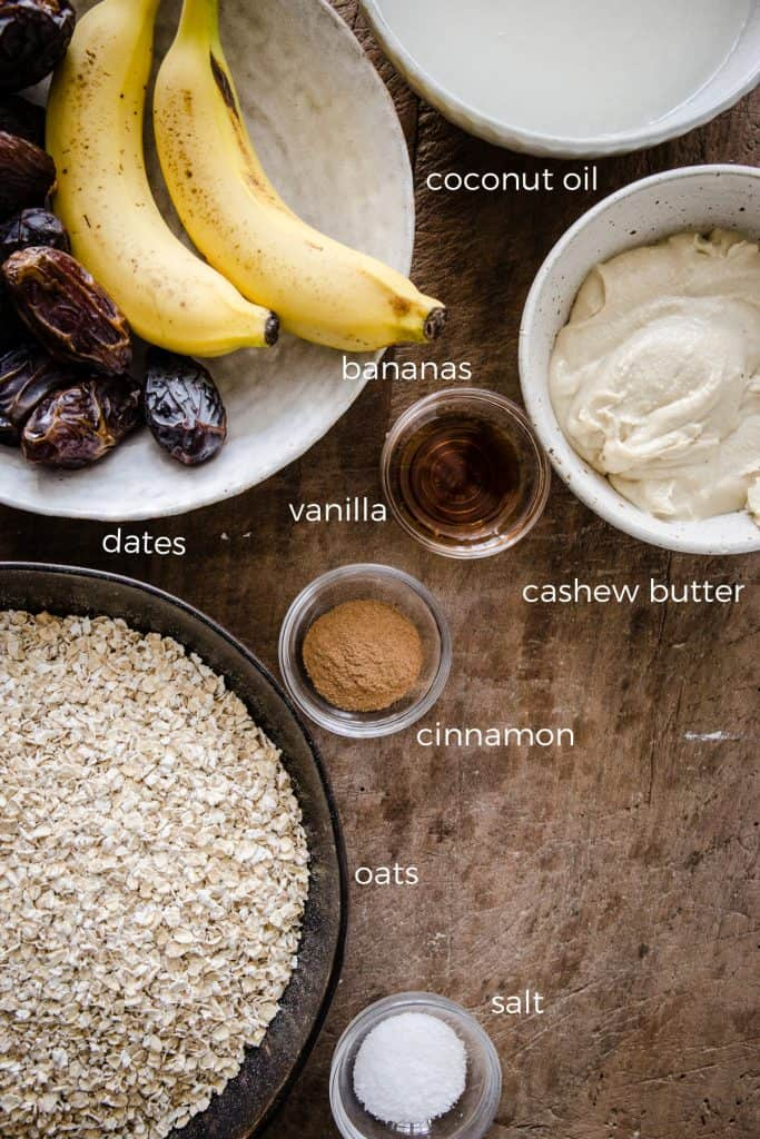 ingredients for banana flapjacks on a wooden board