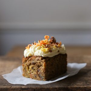 This gluten-free Golden Beetroot Carrot Cake is the best carrot cake you will ever taste. Full of sweet earthy goodness thanks to using both golden beetroot and carrots; complex with pecans, sultanas and apples; perfectly complimented with a not too sweet cream cheese buttercream and adorned with the delightful crunch of a salted pecan praline and candied beetroot and carrots.