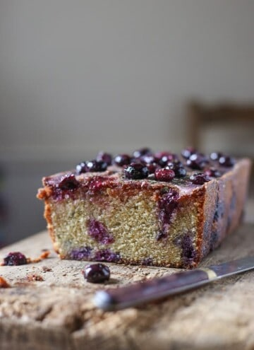 Singing with citrusy aromatic flavour this gluten-free Blueberry Basil Lemon Drizzle Loaf is a showstopper of an everyday teatime cake.