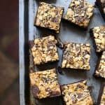 Gluten-free Black Sesame Peanut Butter Brownies are packed with honeyed black sesame, swirled generously with peanut butter layered through the brownie and topped with salted peanuts and black sesame.