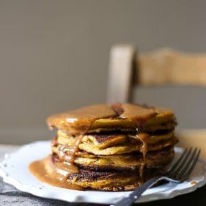 Gluten-free Pumpkin Pancakes, so thick and fluffy and smothered with Almond Maple Syrup
