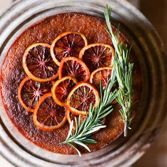 This Blood Orange Rosemary Polenta Cake is both gluten-free and dairy-free. Whole oranges are boiled then pureed to create an incredibly moist and intensely citrusy cake spiked with a hint of rosemary.