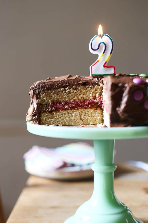 Best Gluten-Free Birthday Cake - a light and fluffy vanilla gluten-free sponge cake, sandwiched with a raspberry crush filling and covered in a whipped chocolate cream cheese ganache.