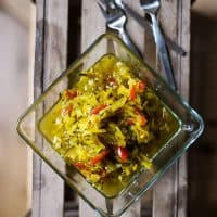 Courgette Relish on a wooden box with forks