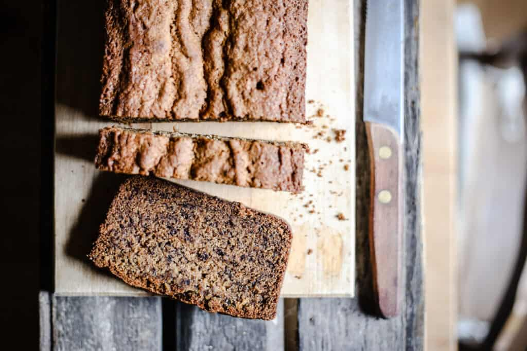 Sliced Gluten-Free Banana Bread on a wooden board