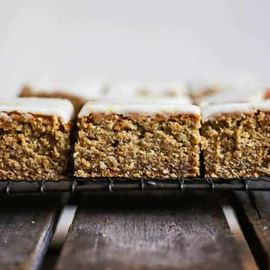 side view of Lemon Iced Stem Ginger Parkin on a wire rack