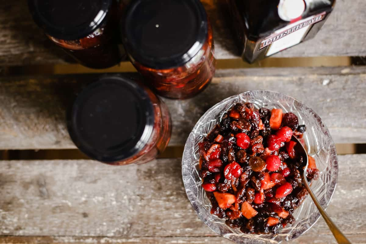 Boozy Cranberry Mincemeat with Cointreau in a glass bowl on a wooden table