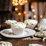 Mince Pie Cupcakes surrounded by christmas decorations and twinkling lights