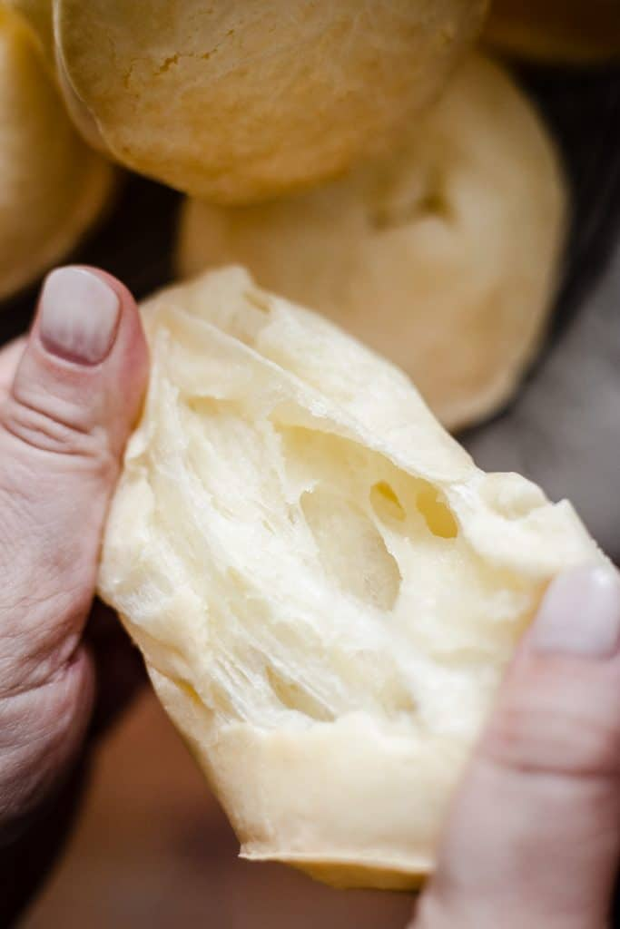 Cheese Roll being pulled apart to show cheesy inside
