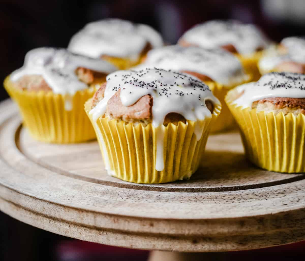 Lemon and Poppy Seed Muffins on a wooden cake stand