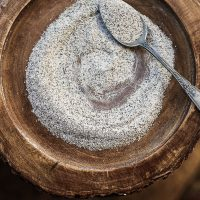 Buckwheat Flour on a wooden board with a spoon