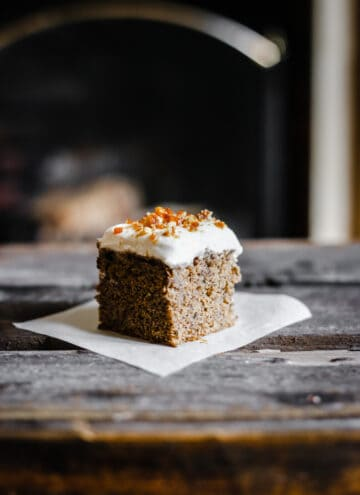 Coffee and Walnut Tres Leches Cake on a plate on a wooden table