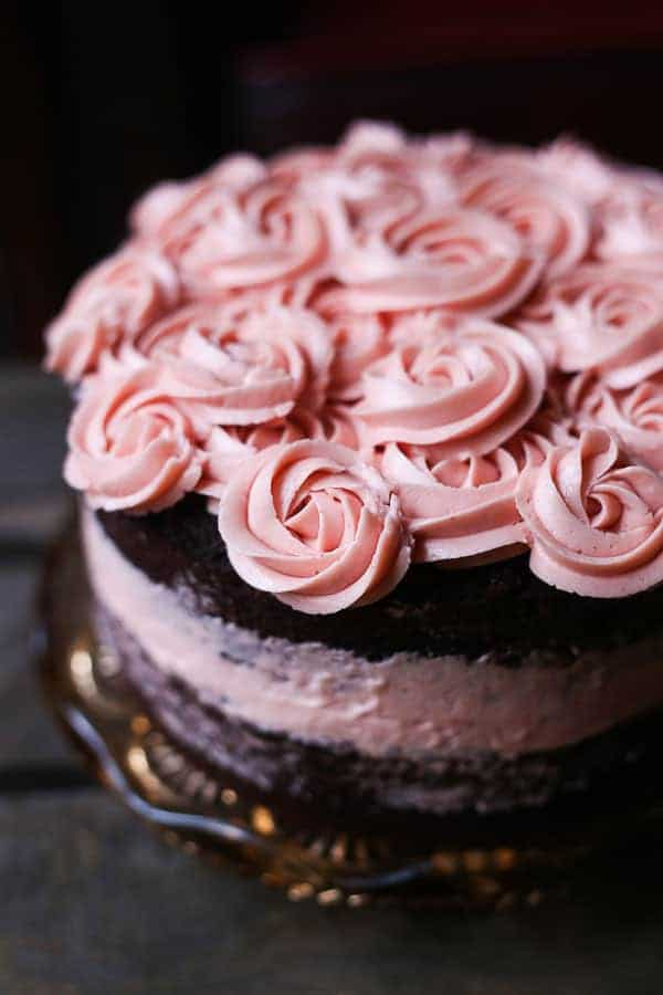 This Chocolate Raspberry Cake is a foolproof gluten-free buttermilk chocolate cake, sandwiched with a simple fresh raspberry swiss meringue buttercream.