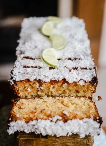 Cut slices of Coconut Lime Drizzle Cake on a wooden box