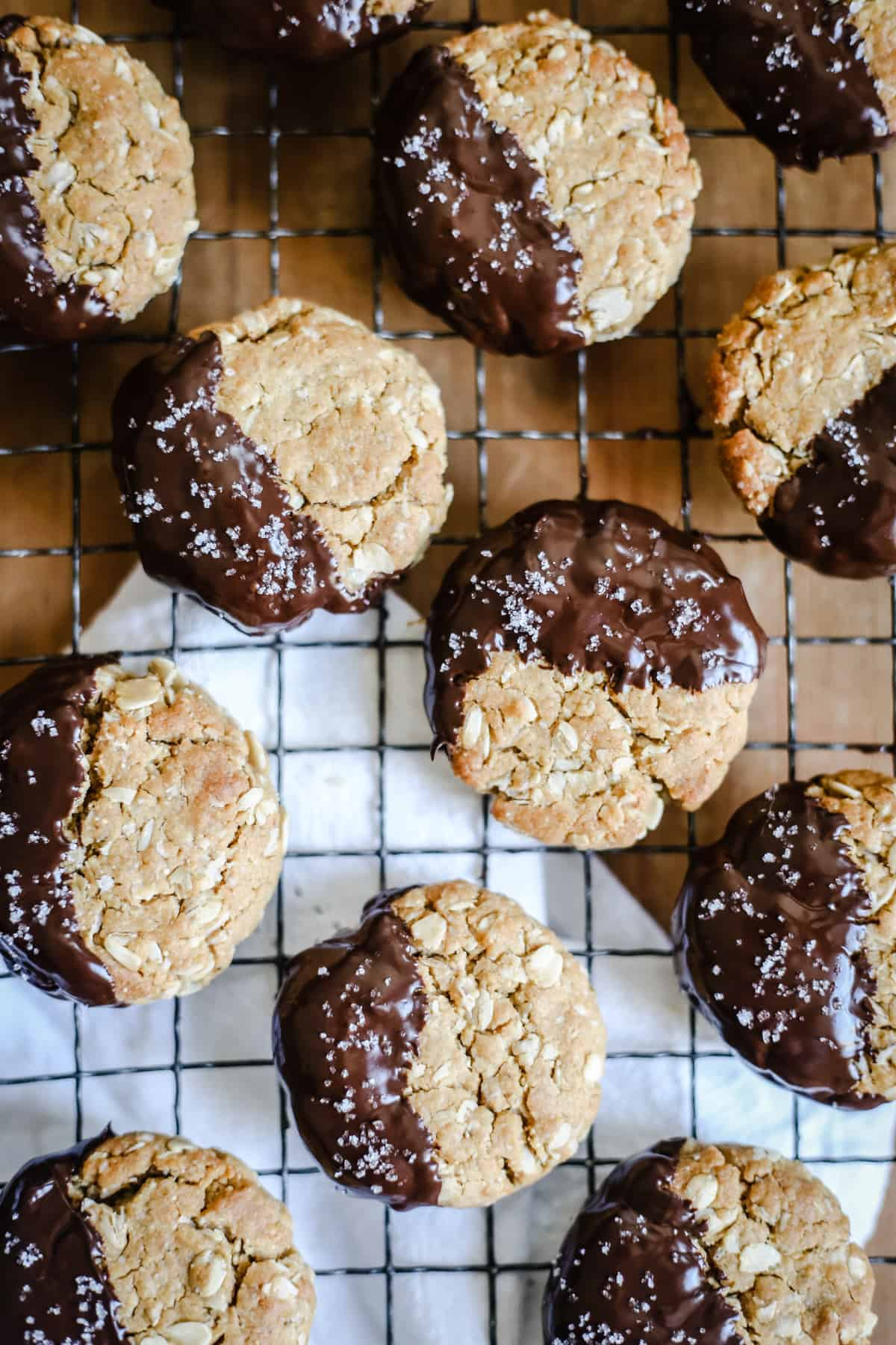 Gluten-Free Chocolate-Dipped Oat Peanut Butter Cookies on a wire rack