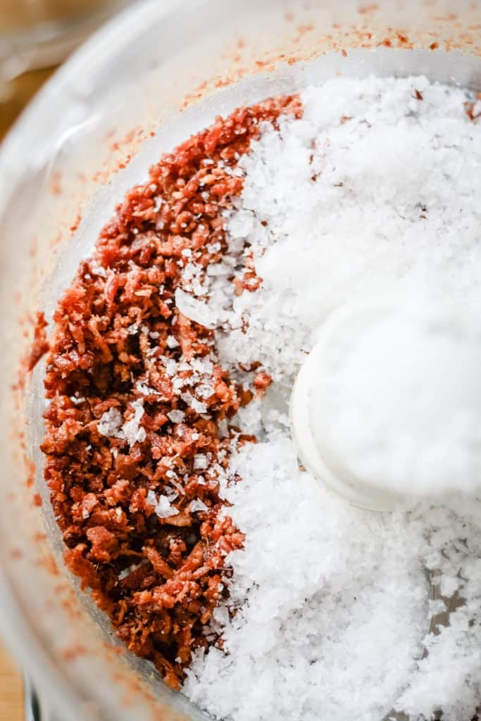 Crumbled bacon and sea salt in a food processor