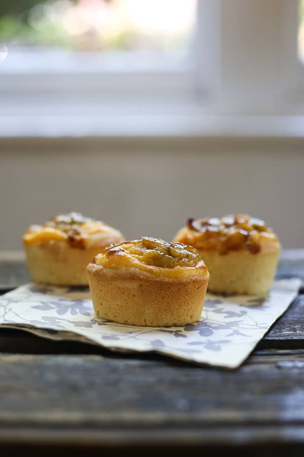 gooseberry friands on a napkin on a wooden table