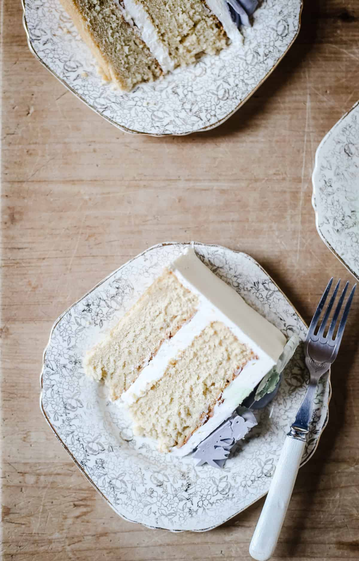 slices of Best Gluten-Free Vanilla Cake on a wooden table