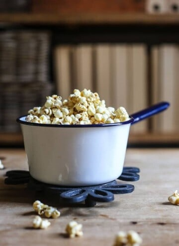 Buttered Maple and Bacon Salt Popcorn in a saucepan on a table