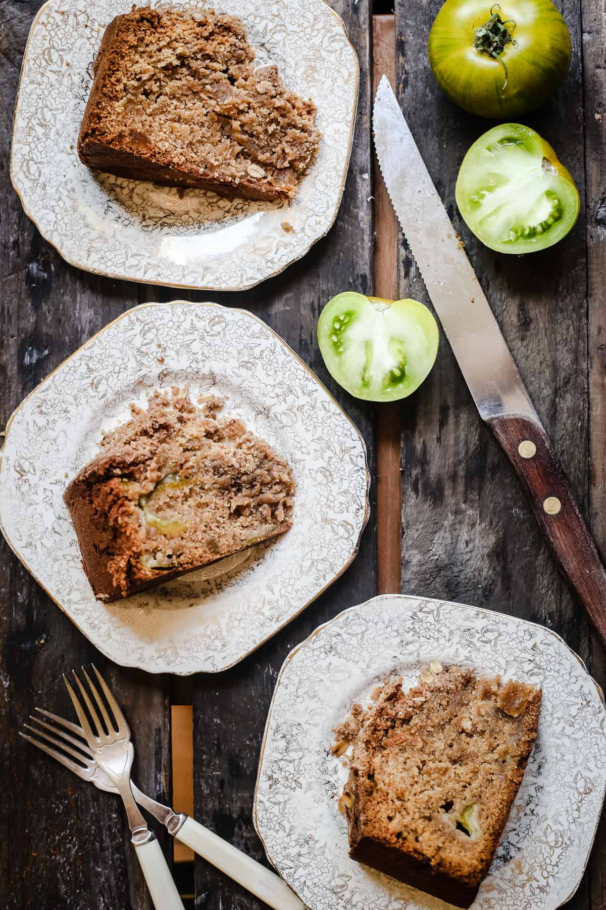 overhead shot of slices of Green Tomato and Stem Ginger Cake with Streusel Topping {gluten-free} on a plate with green tomatoes next to it