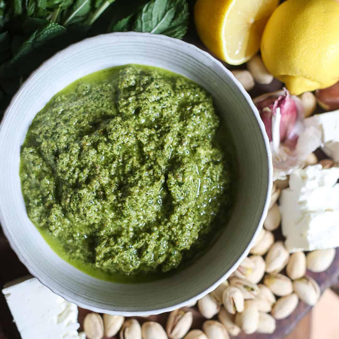 overhead shot of a bowl of Feta Pistachio Mint Pesto