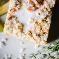 A slice of Apple Cheddar Thyme Crumble Cake on a plate