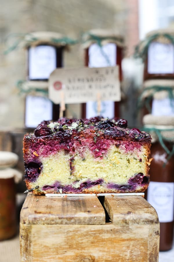 Blueberry Basil Lemon Drizzle Cake on a wooden board