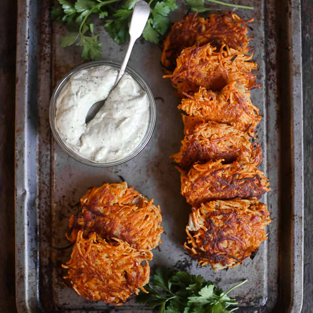 overhead shot of Sweet Potato and Bacon Rosti on a metal tray with tahini sauce