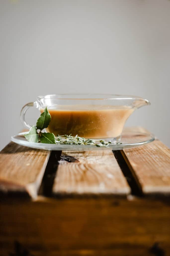 Gluten-Free Gravy in a gravy boat on a wooden table