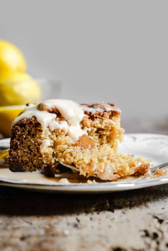 Lemon and Ginger Cake on a plate drizzle with lemon custard