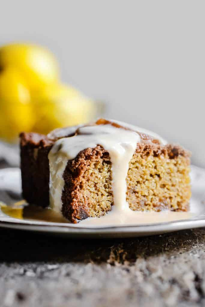 Lemon and Ginger Cake on a plate drizzled with lemon custard