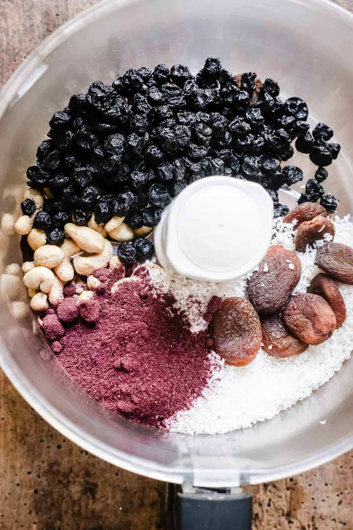 ingredients for Raw Blueberry Coconut Energy Bars in a food processor