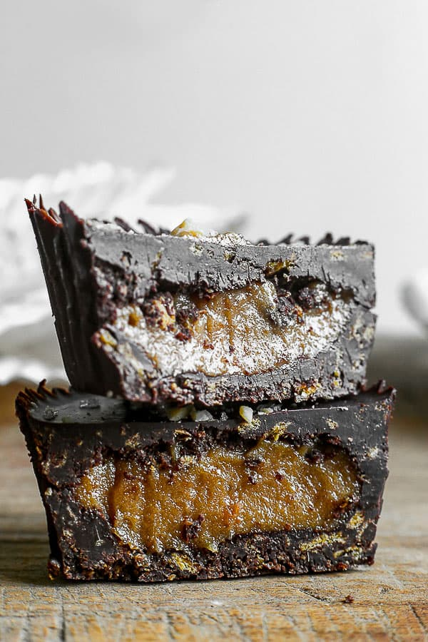 Chocolate Peanut Butter Caramel Crunch Cup cut in half and stacked up on each other