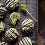 Coconut Matcha Macaroons on a wire rack