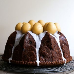 Simnel Cake on a wire rack on a wooden board