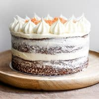 gluten-free carrot cake on a wooden plate on a table