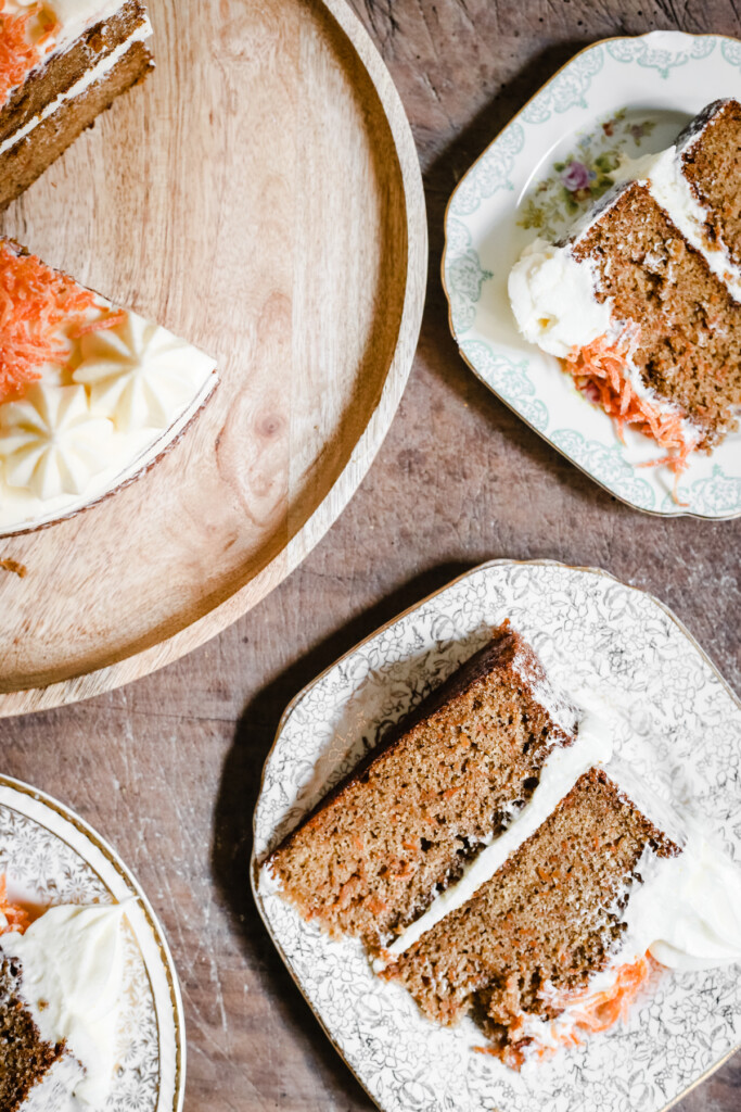 overview of a cut gluten-free carrot cake with slices on plates next to it