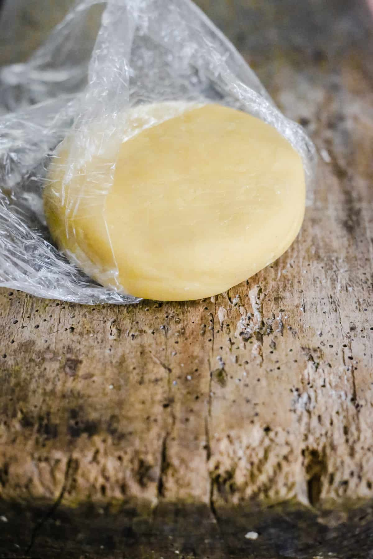 homemade marzipan dough on a wooden board