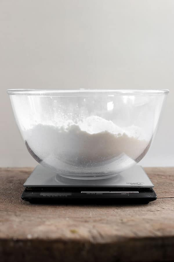flour in a mixing bowl on a set of scales