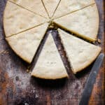 Gluten-free shortbread on a wooden board cut into pieces