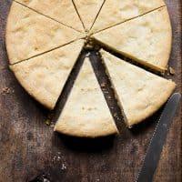 Gluten-free shortbread on a wooden board cut into pieces