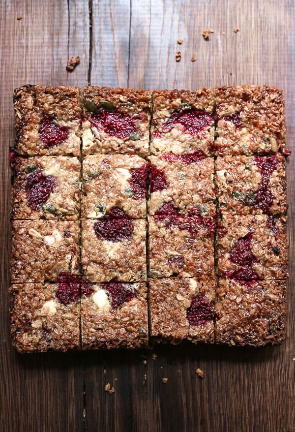 White Chocolate Raspberry Flapjacks cut on a wooden board